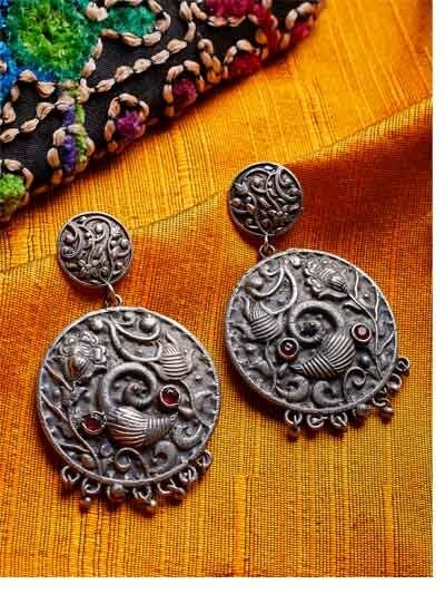 Flowery Brass Based Oxidized Silver Earrings With Red Stones and Intricate Leafy Embellishments