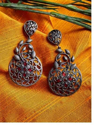 Petals and Leaves Brass Based Oxidized Silver Earrings Embellished With Floral Motifs and Red Stones