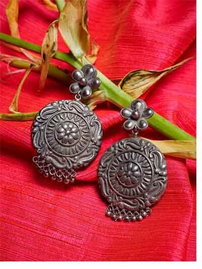 Circular Brass Based Oxidized Silver Earrings With Hanging Metallic Bells and Floral Motifs