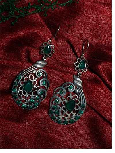 Brass Based Oxidized Silver Earrings Embellished With Floral Motifs and Beautiful Green Stones