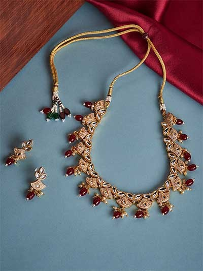 Gold Plated Off White and Maroon Kundan Meena Studded Jewellery Set