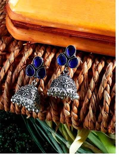 Brass Based Oxidized Silver Jhumkis Embellished With Navy Blue Stones