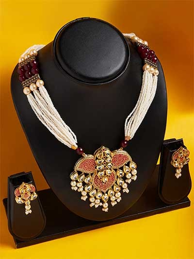 Gold-Toned Pink Handcrafted Kundan Necklace Set