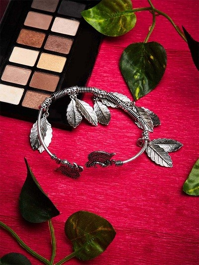 Hanging Metallic Leaves and Peacock Embellished Oxidized Tribal Jewellery Cuff Bracelet