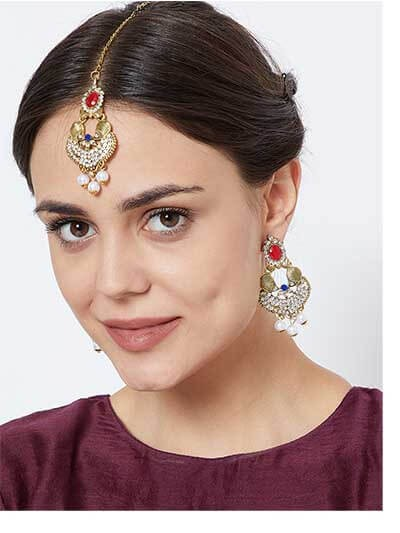 Traditional Red Stone Embellished and White Stones Studded with Hanging White Pearls Golden Earrings and Maang Tika Jewellery Set for Wedding.