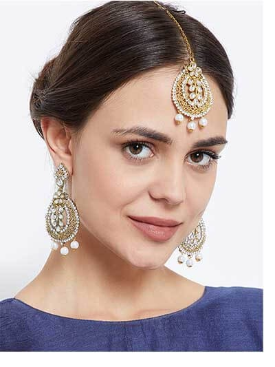 Timeless Leaf Like Kundan Embellished and Stone Studded with Hanging Pearls golden Earrings and Maang Tika Jewellery Set for Wedding