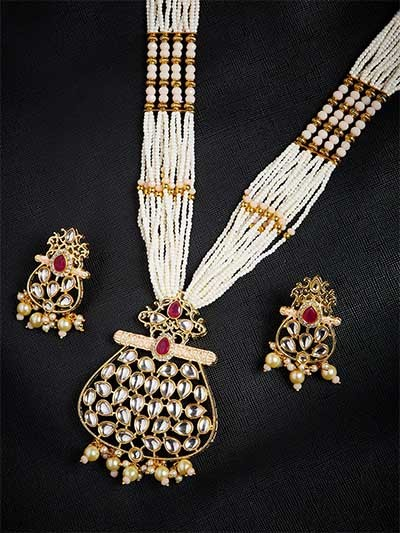 Gold-Toned and Peach Kundan Stone Studded Jewellery Set