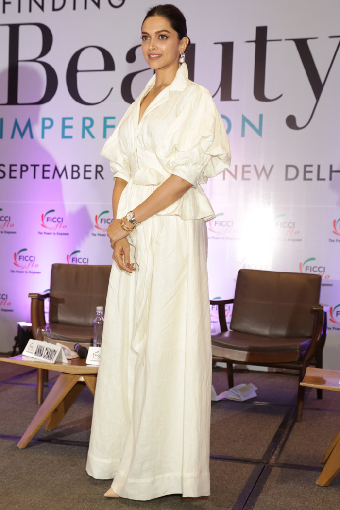 Deepika in an all-white attire and pearl jewellery